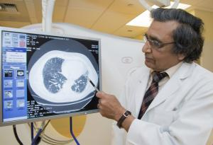 Dr. Ganesh Raghu with a CT image of pulmonary fibrosis. Clare McLean/UW Medicine.